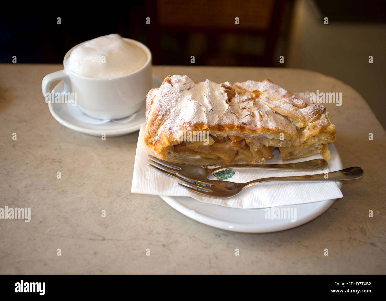 Apple strudel and cappuccino served in the Tomaselli Cafe in the Altstadt, Salzburg, Austira - Stock Image