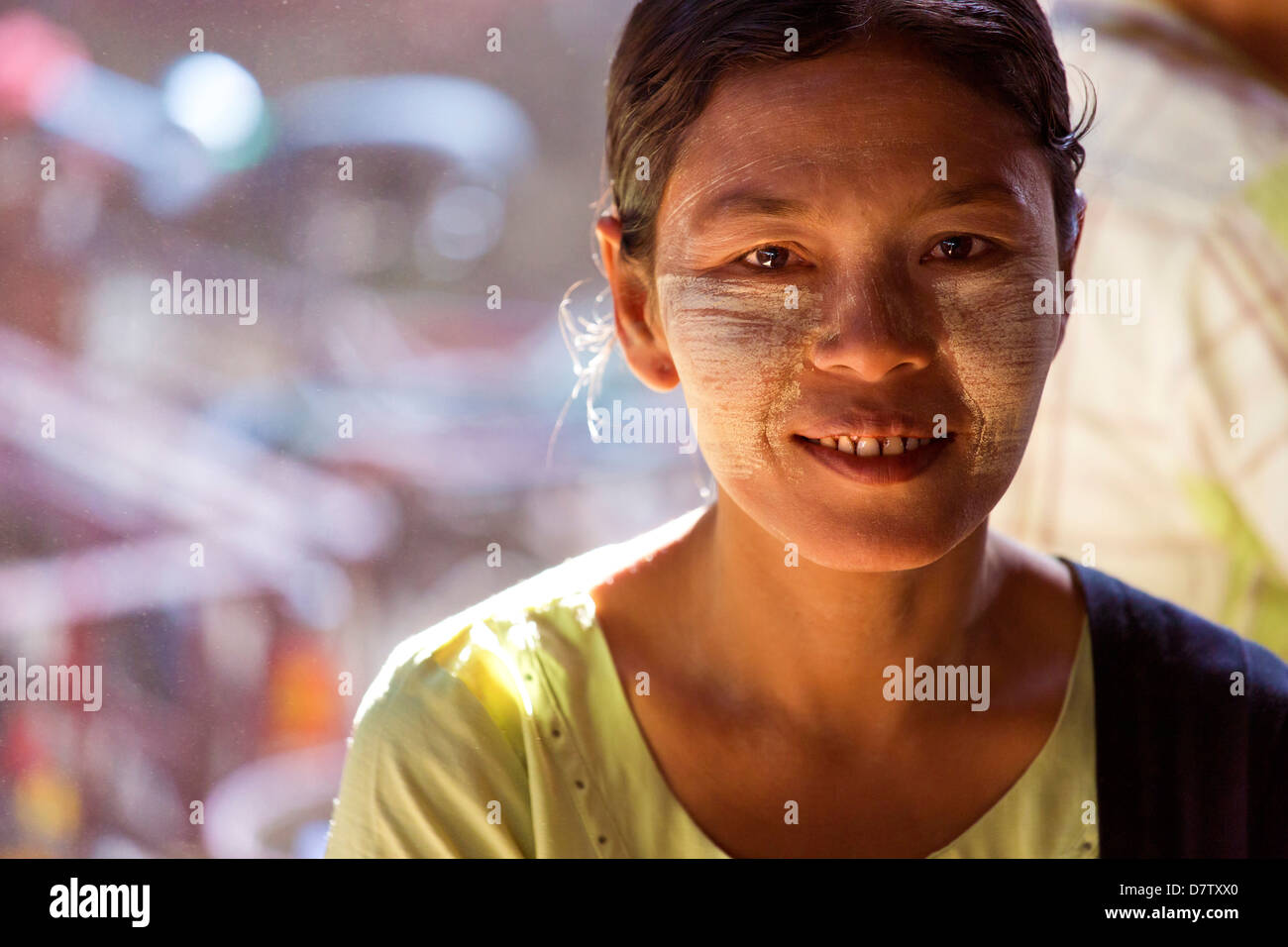 Local woman with Thanakha traditional face painting, Thiri Mingalar Market, Yangon (Rangoon), Burma - Stock Image