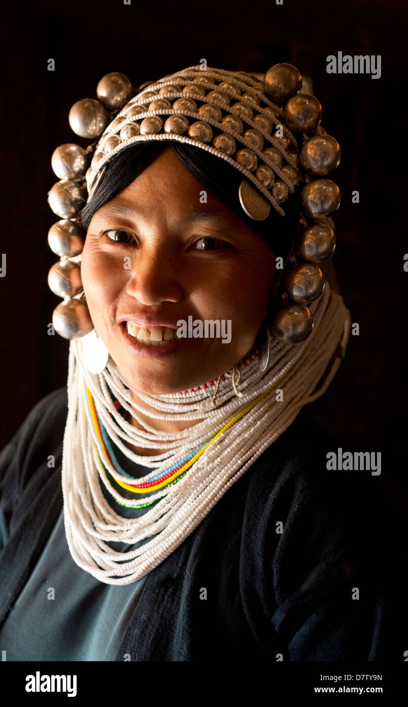 Woman of the Akha tribe in traditional dress, in a hill village near Kengtung (Kyaingtong), Shan State, Burma - Stock Image