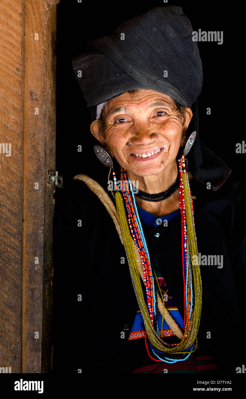 Woman of the Ann tribe in traditional black dress and colourful beads in a hill village near Kengtung, Shan State, - Stock Image