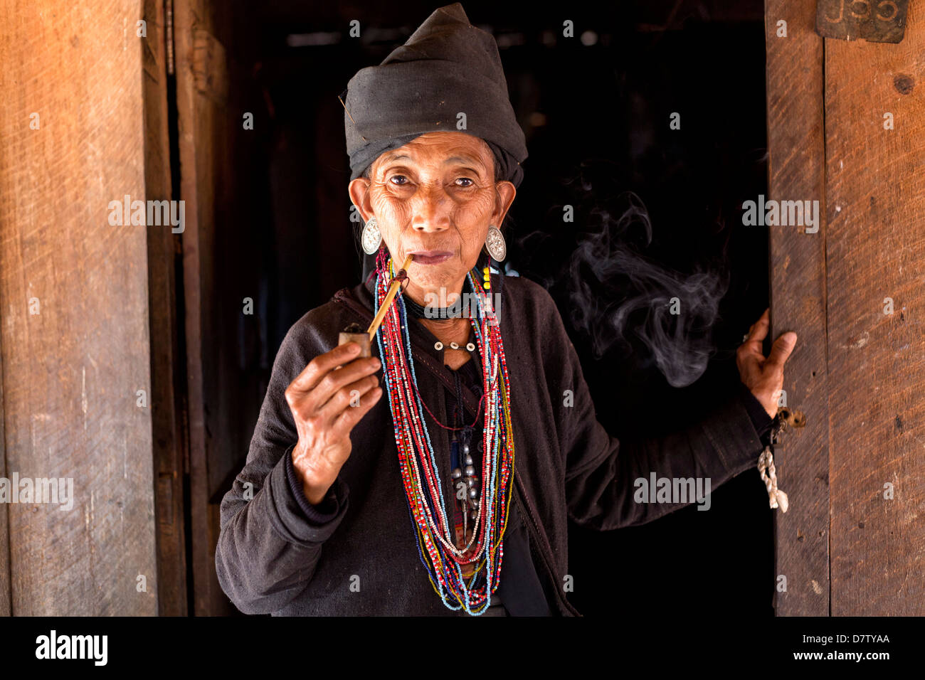 Woman of the Ann tribe in the doorway of her home in a hill village near Kengtung, Shan State, Burma - Stock Image