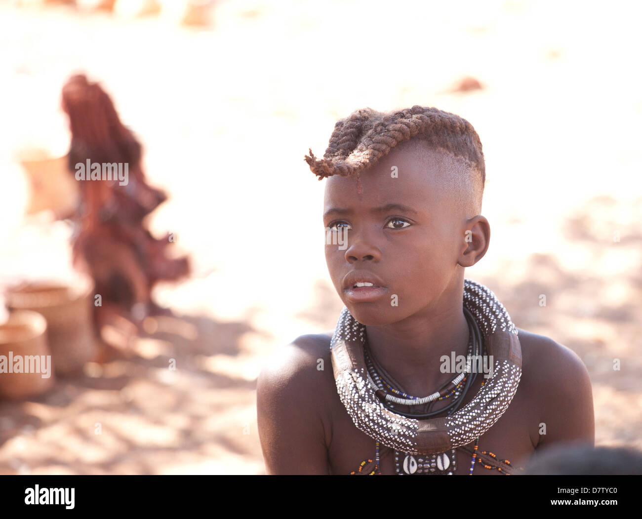 Young Himba boy with plaited hair, Kunene Region (formerly Kaokoland) in the far north of Namibia - Stock Image