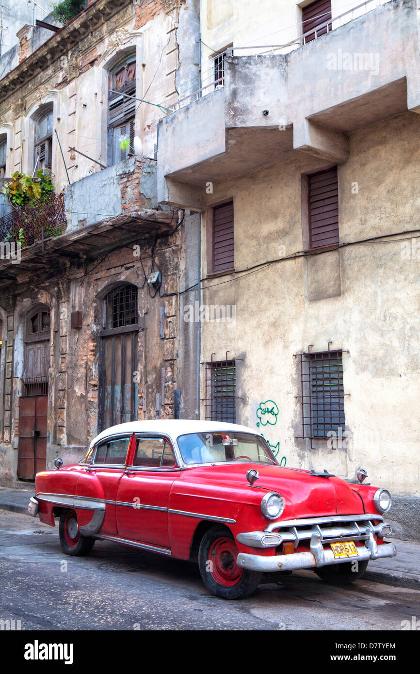 Red vintage American car parked on a street in Havana Centro, Havana, Cuba, West Indies - Stock Image