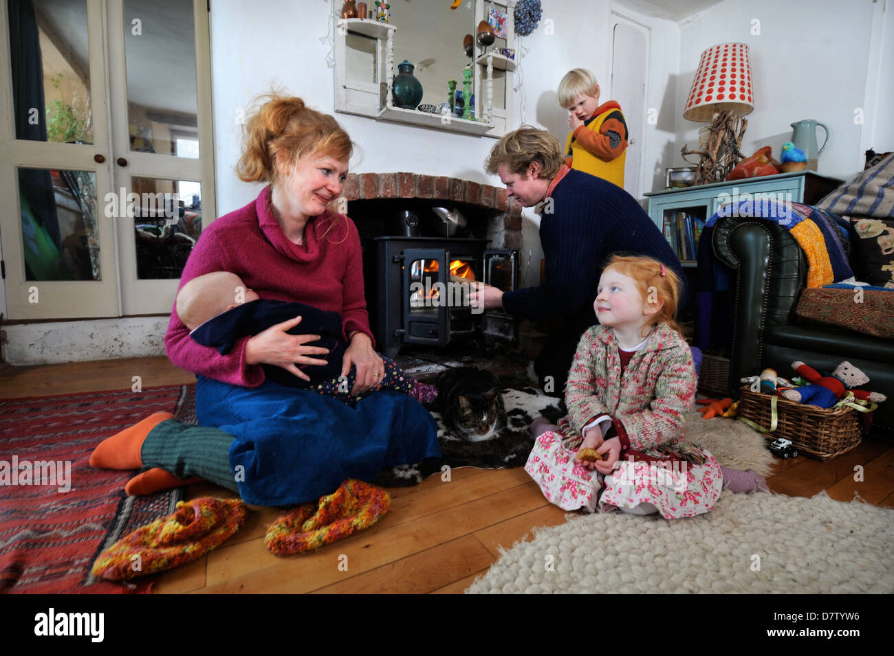 A rural family from Herefordshire who use wood to fuel the heating and cooking range in their house UK - Stock Image