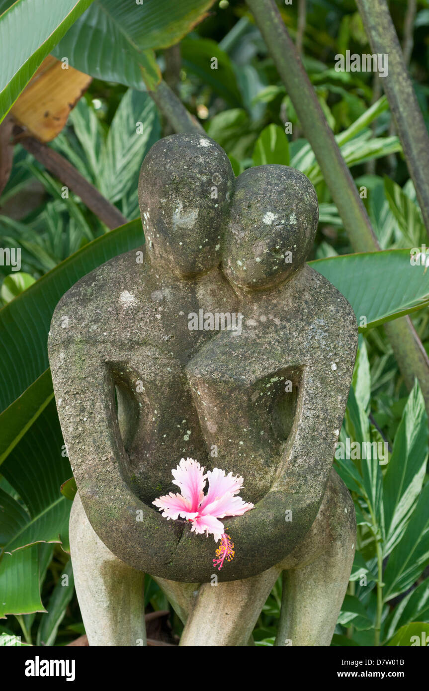 Statue among palm trees of Dunk Island Resort, Great Barrier Reef, Mission Beach, Queensland, Australia - Stock Image