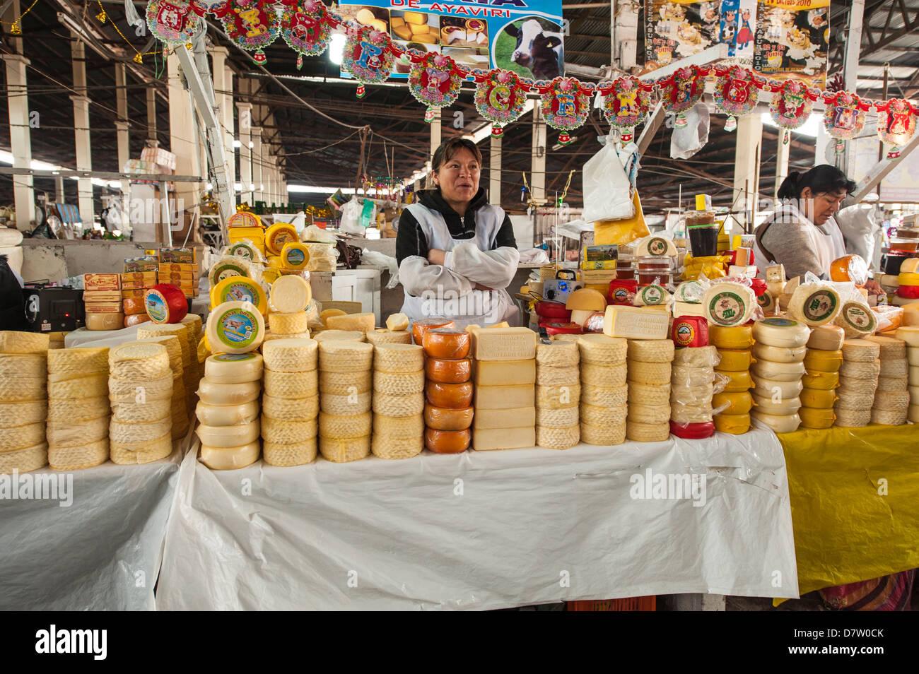 Cheese vendor in local market, Cuzco, Peru, South America - Stock Image