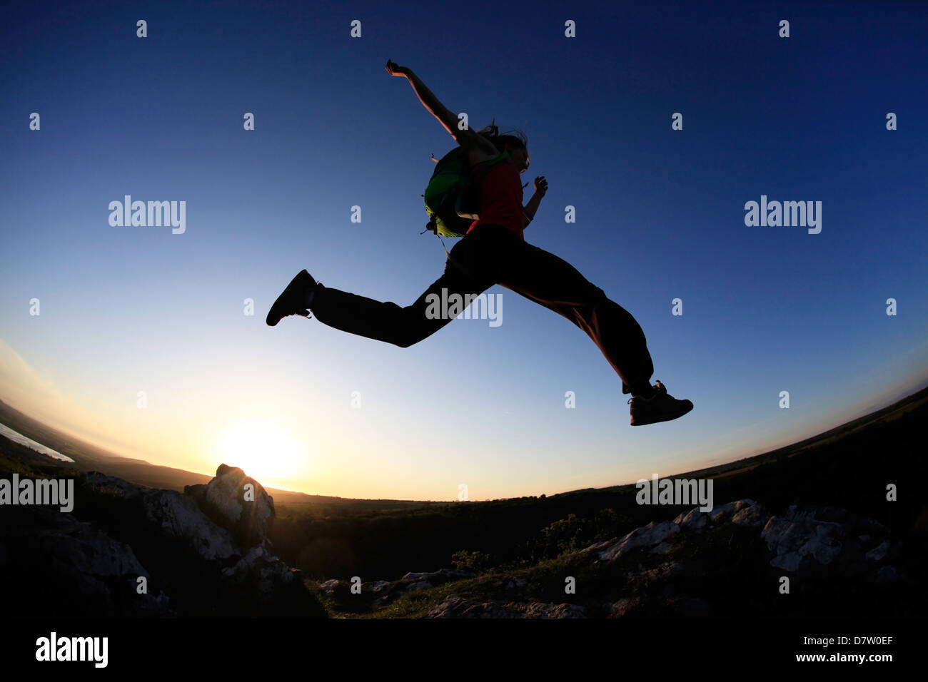 A woman runs in the Mendip Hills, Somerset, England, United Kingdom - Stock Image