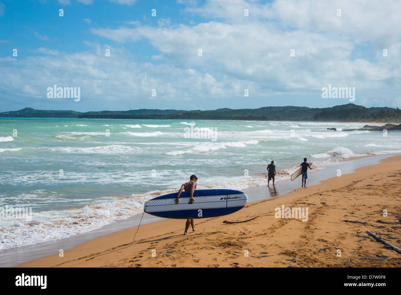 Surfer on Luquillo Beach, Puerto Rico, West Indies, Caribbean - Stock Image