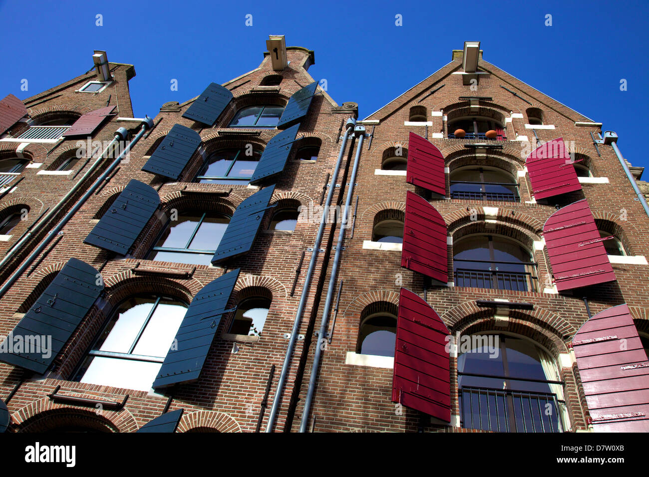 Converted canal warehouses, Amsterdam, Netherlands - Stock Image