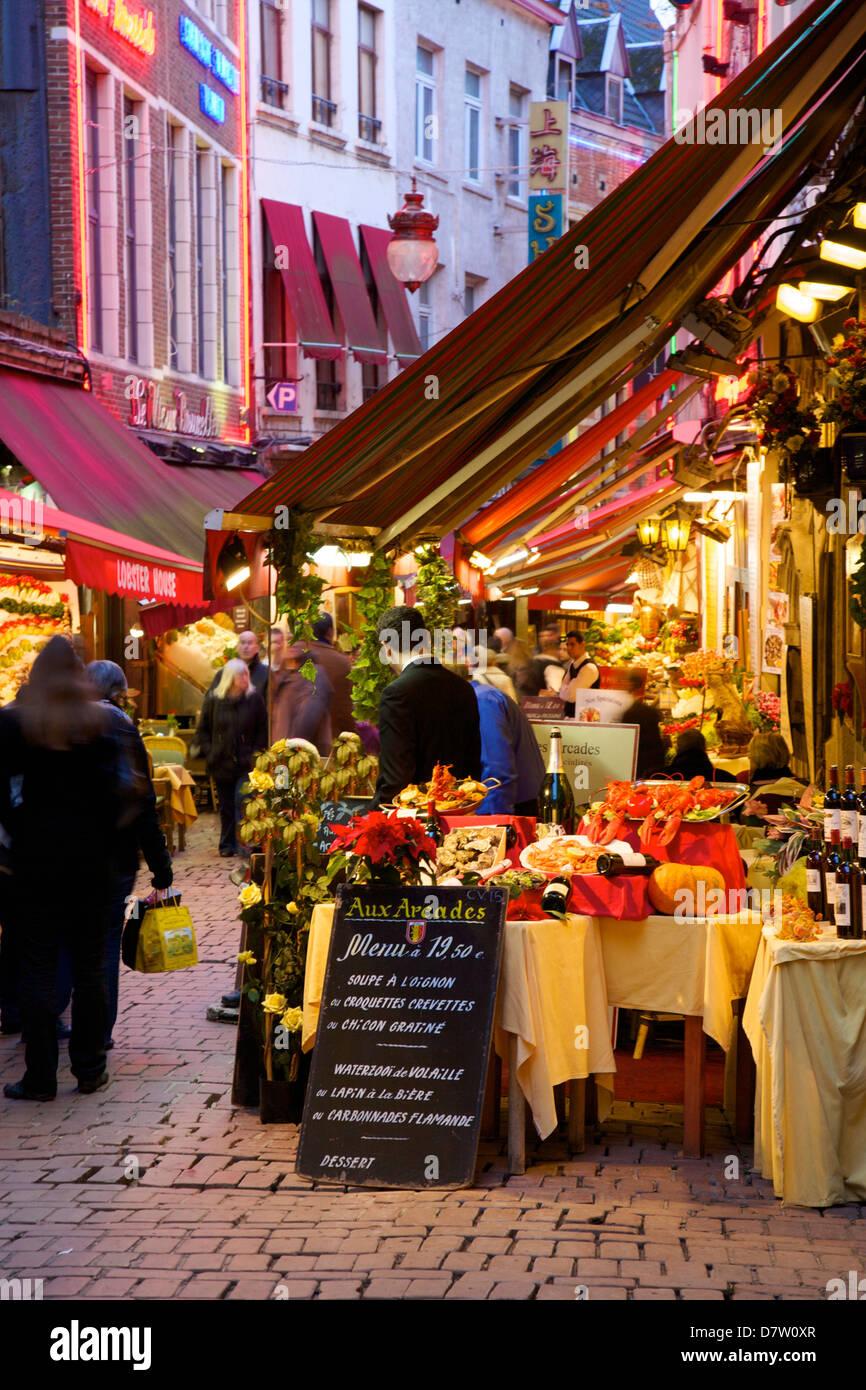 Restaurants in Rue des Bouchers, Brussels, Belgium - Stock Image