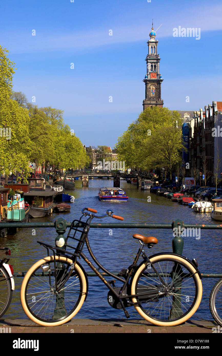 Westerkerk Tower and Prinsengracht Canal with bicycle, Amsterdam, Netherlands - Stock Image