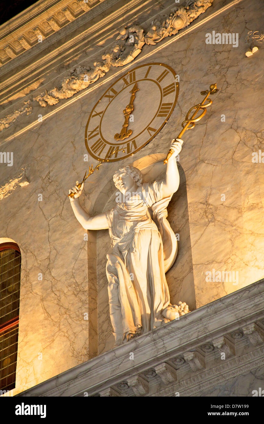Clock and statue in Royal Palace, Amsterdam, Netherlands - Stock Image