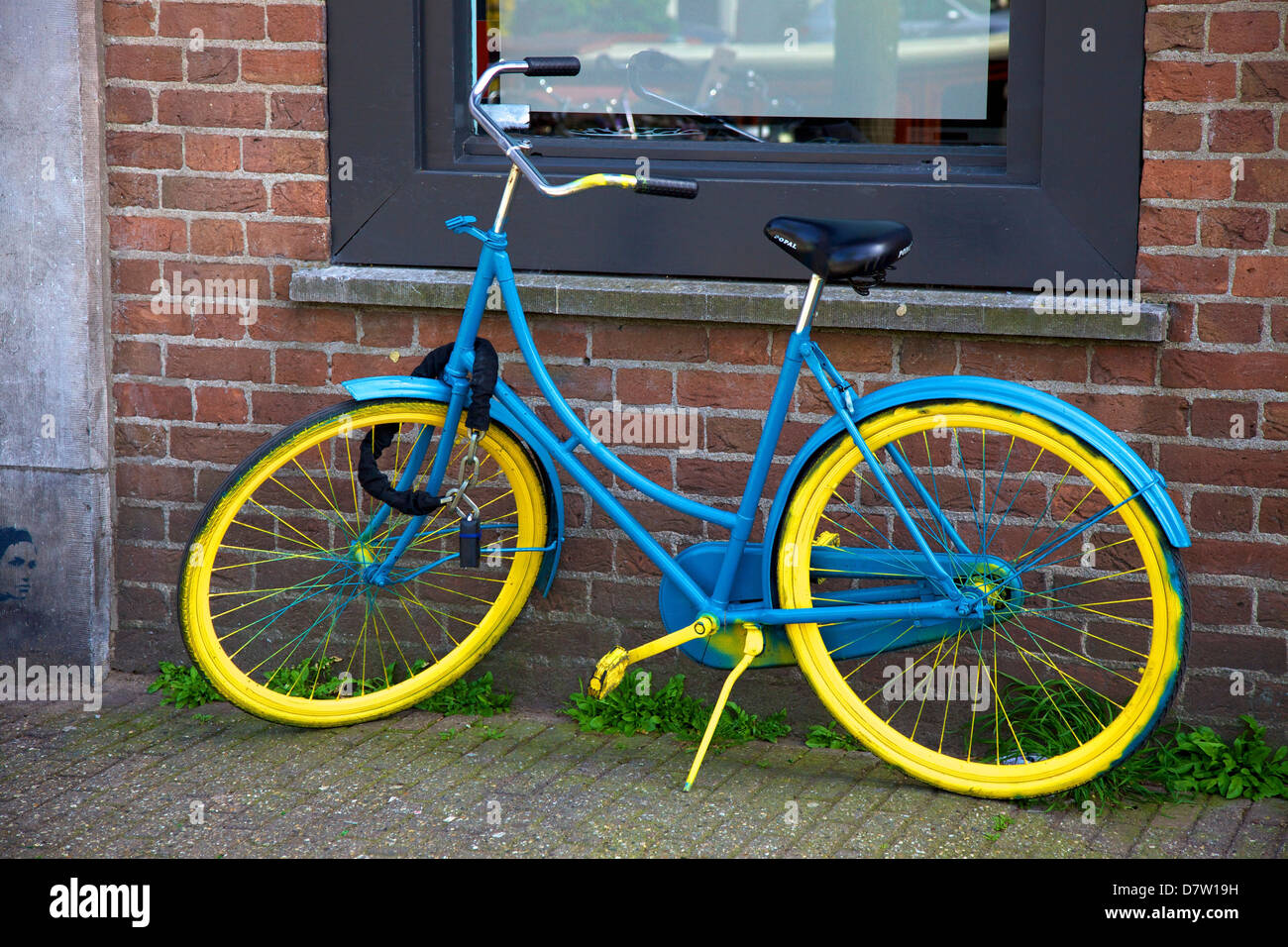 Blue and yellow bicycle, Amsterdam, Netherlands - Stock Image