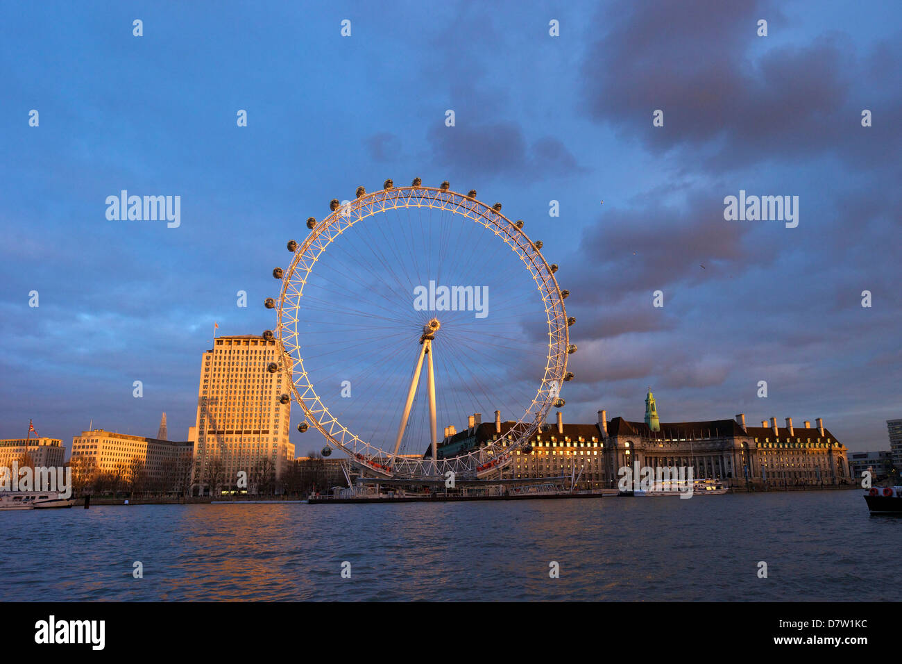 London Eye, River Thames, and City Hall from Victoria Embankment at sunset, London, England, United Kingdom Stock Photo