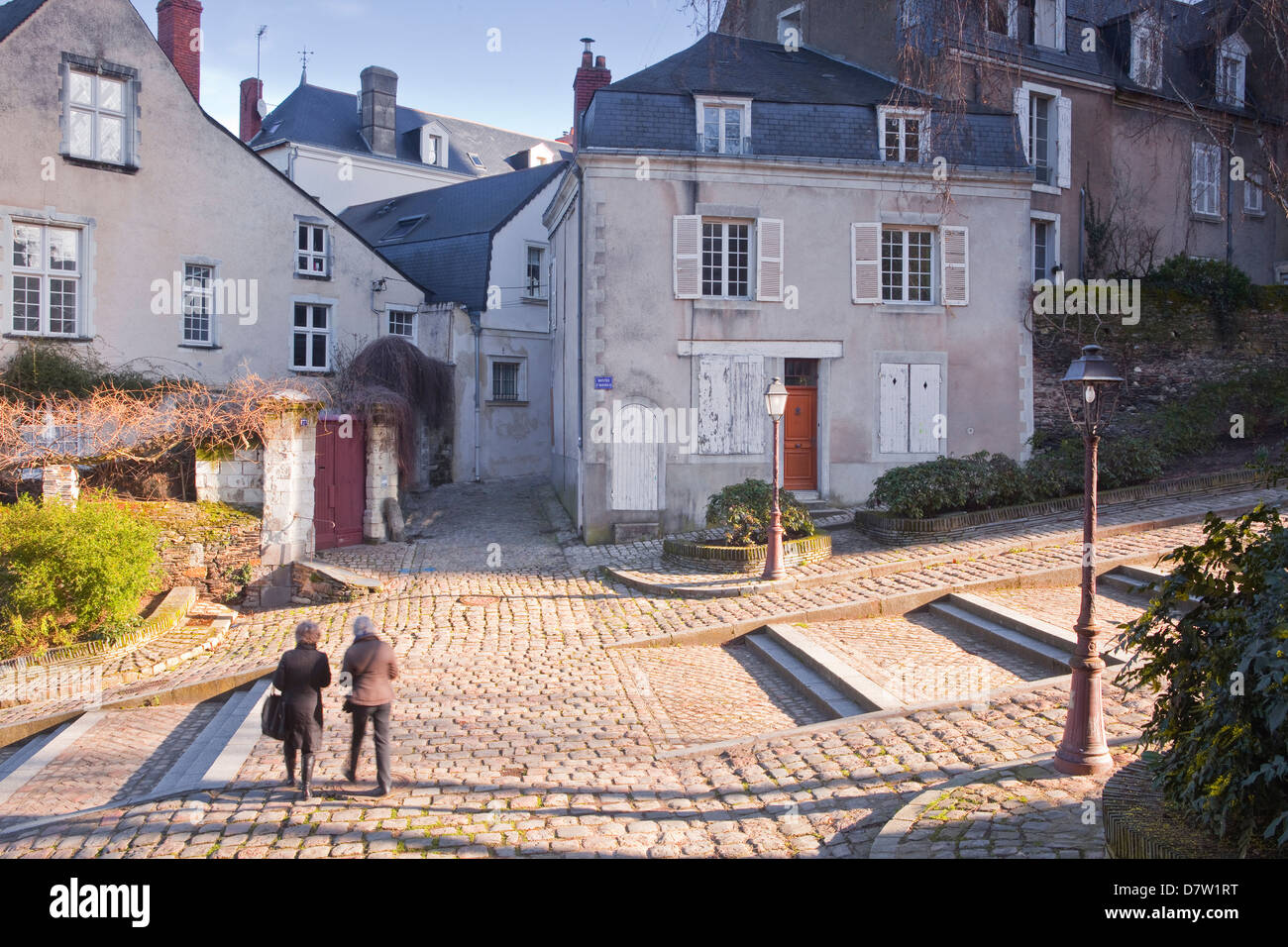 People walking through the old part of the city of Angers, Maine-et-Loire, France Stock Photo