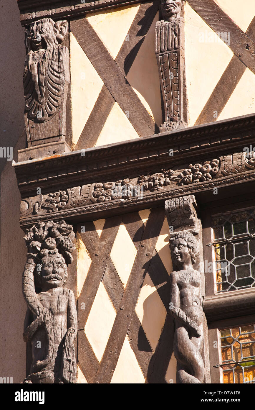Wooden sculptures adorn a half-timbered house in Angers, Maine-et-Loire, France - Stock Image