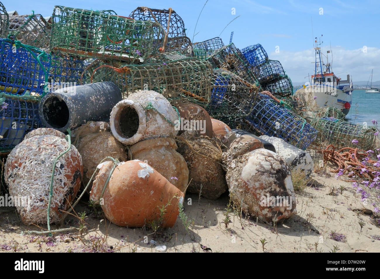 Stack of lobster pots and ceramic octopus pots on Culatra island, Parque Natural da Ria Formosa, near Olhao, Algarve, - Stock Image