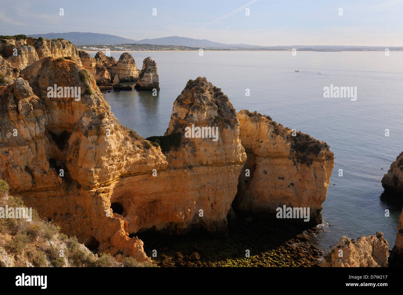 Weathered sandstone cliffs and sea stacks at Ponta da Piedade, Lagos, Algarve, Portugal - Stock Image