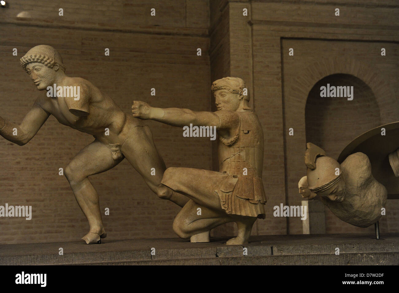 East Pediment's Group of the Temple of Aegina. Ca. 490 BC. Helper, kneeling archer, Herakles, and a injured - Stock Image