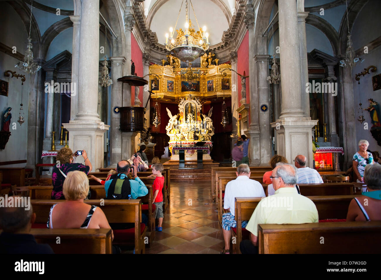 Tourists inside the Church of St. Blaise, Dubrovnik Old Town, UNESCO World Heritage Site, Dubrovnik, Croatia - Stock Image
