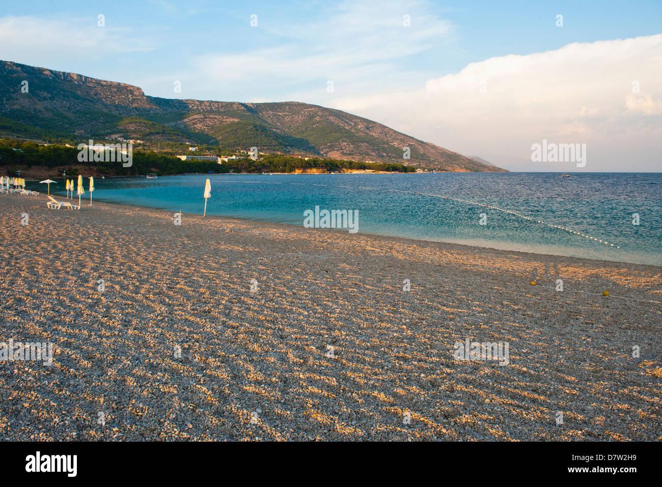 Zlatni Rat Beach at sunset, Bol, Brac Island, Dalmatian Coast, Adriatic, Croatia - Stock Image