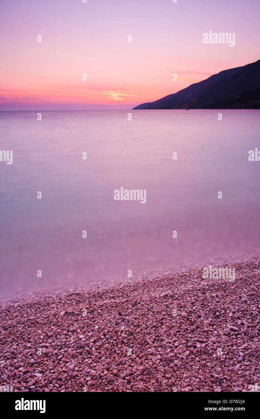 Adriatic Sea at Zlatni Rat Beach at sunset, Bol, Brac Island, Dalmatian Coast, Croatia - Stock Image