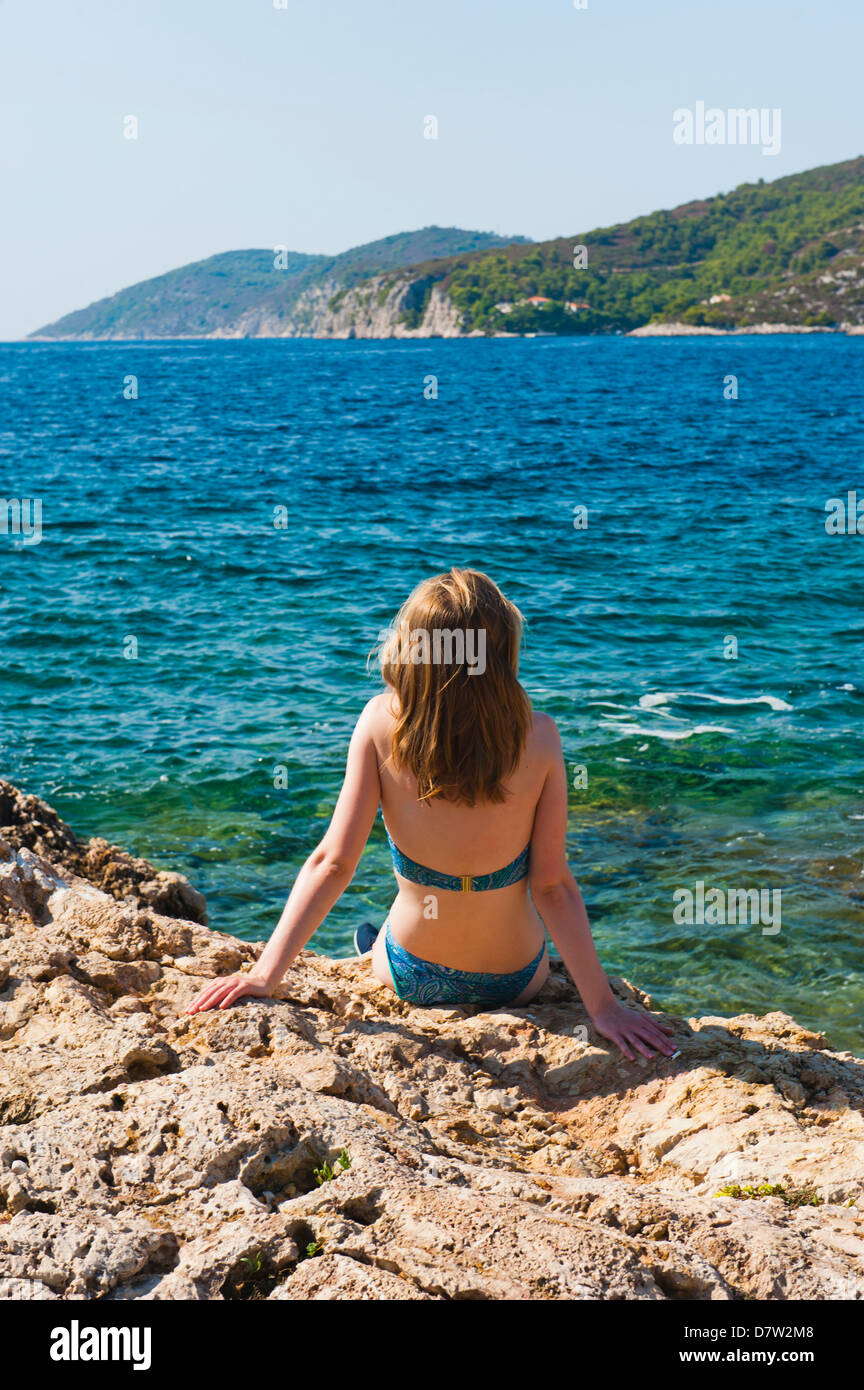 Hvar Town, tourist on a beach, Hvar Island, Dalmatian Coast, Adriatic, Croatia Stock Photo
