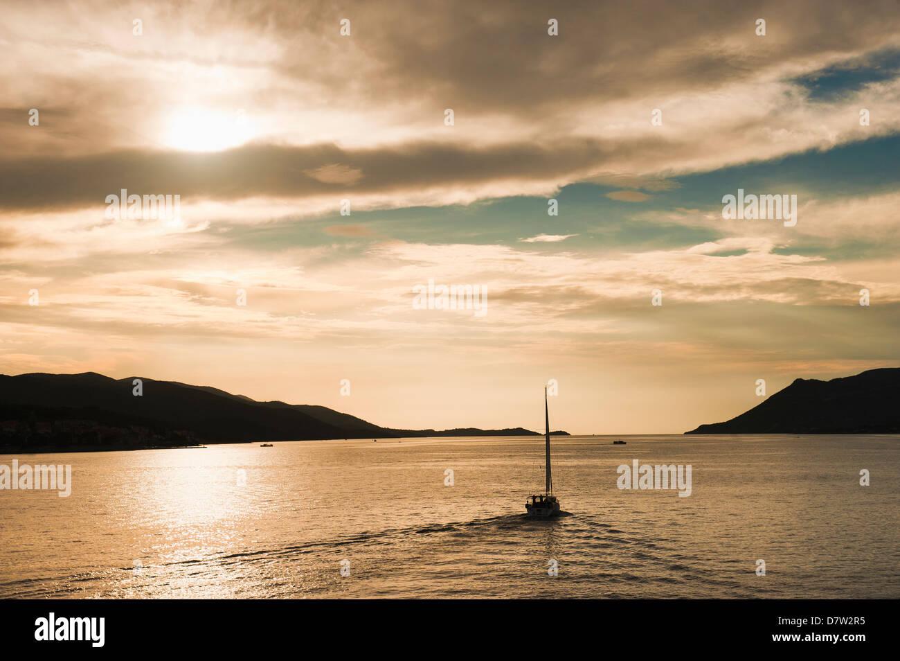 Sailing boat at sunset on the Dalmatian Coast, Adriatic, Croatia - Stock Image