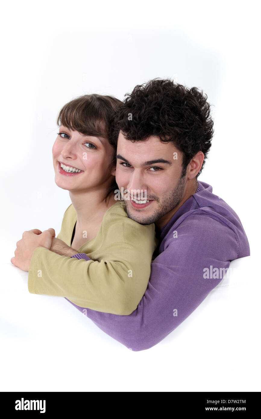 A loving young couple cuddling - Stock Image