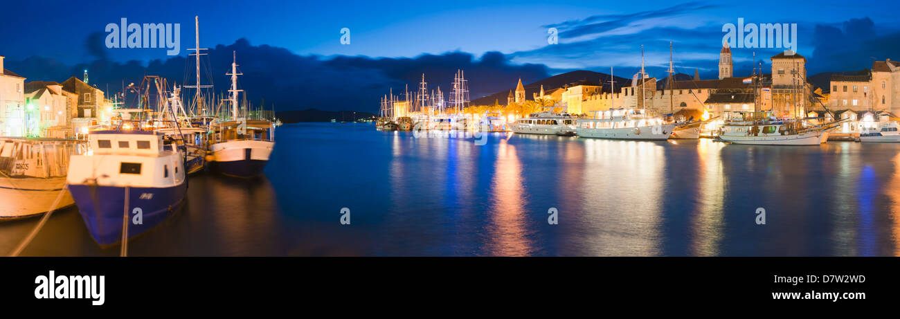Trogir town and boat docks at night, Dalmatian Coast, Adriatic, Croatia - Stock Image