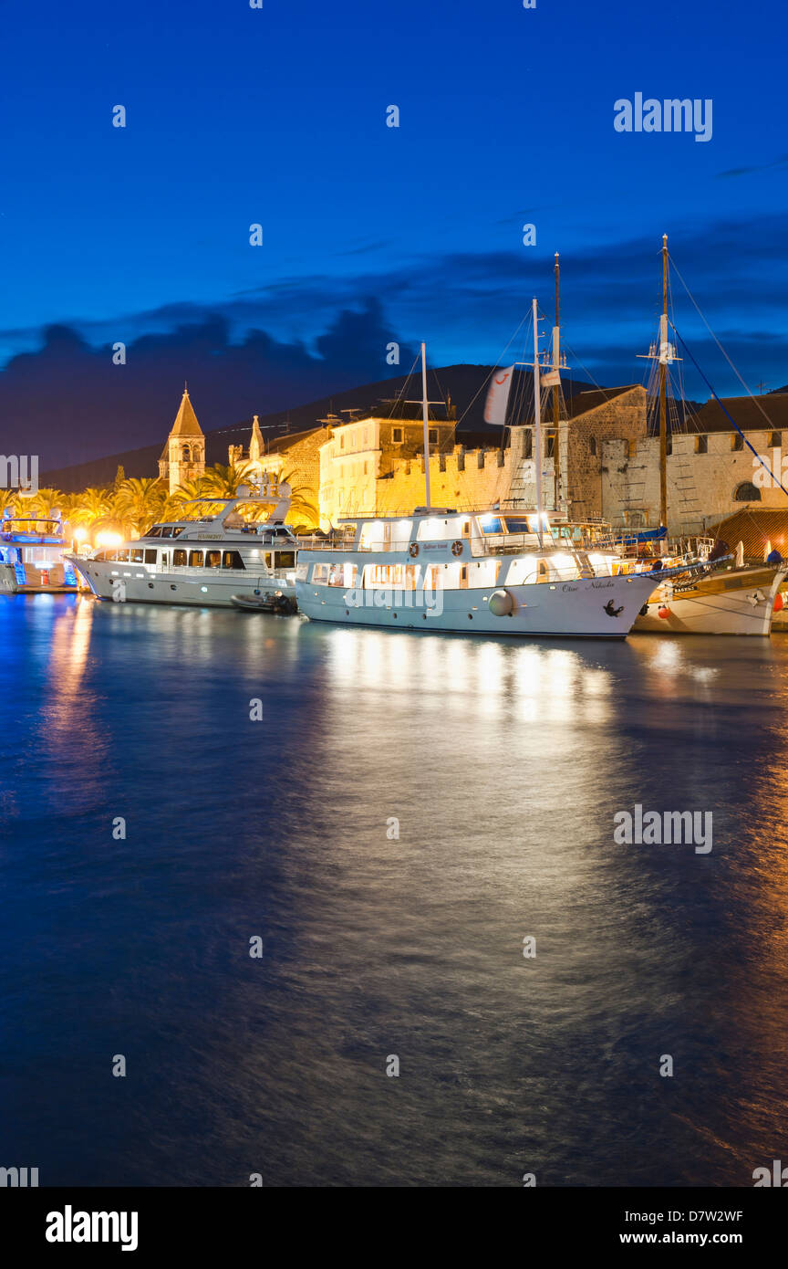 Trogir town with boats in the harbour at night, Dalmatian Coast, Adriatic, Croatia - Stock Image