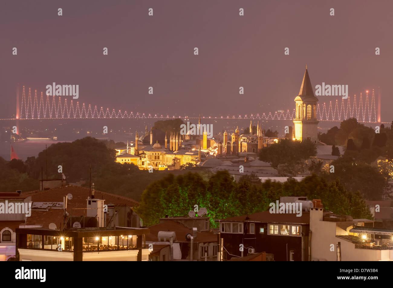 Topkapi Palace and Bosphorus bridge at night, Istanbul, Turkey - Stock Image