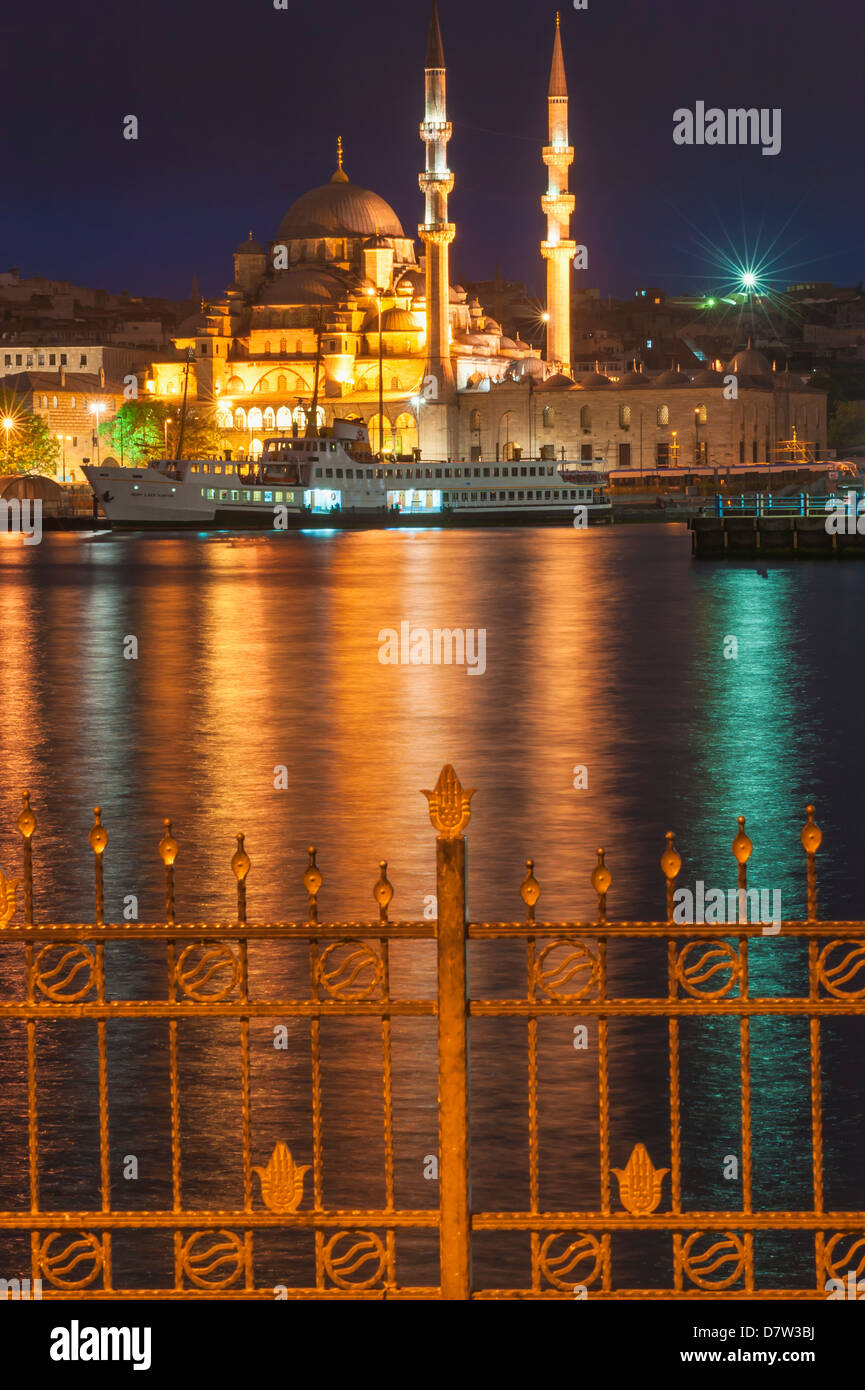 Yeni Cami (New Mosque) at night, Istanbul Old City, Turkey - Stock Image