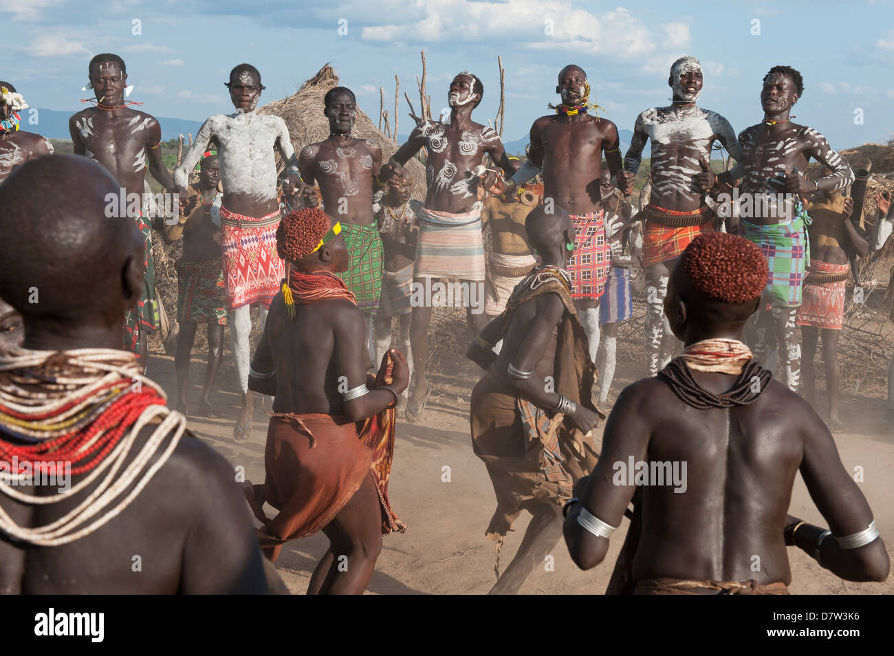 Karo people with body paintings participating in a tribal dance ceremony, Omo River Valley, Southern Ethiopia - Stock Image