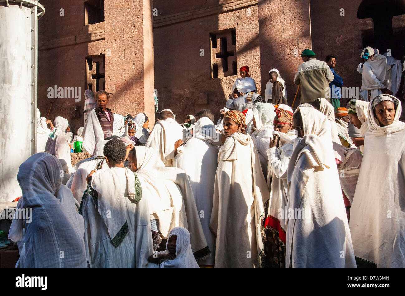 Pilgrims with the traditional white shawl attending a ceremony at the Bete Medhane Alem Church, Lalibela, Amhara, - Stock Image