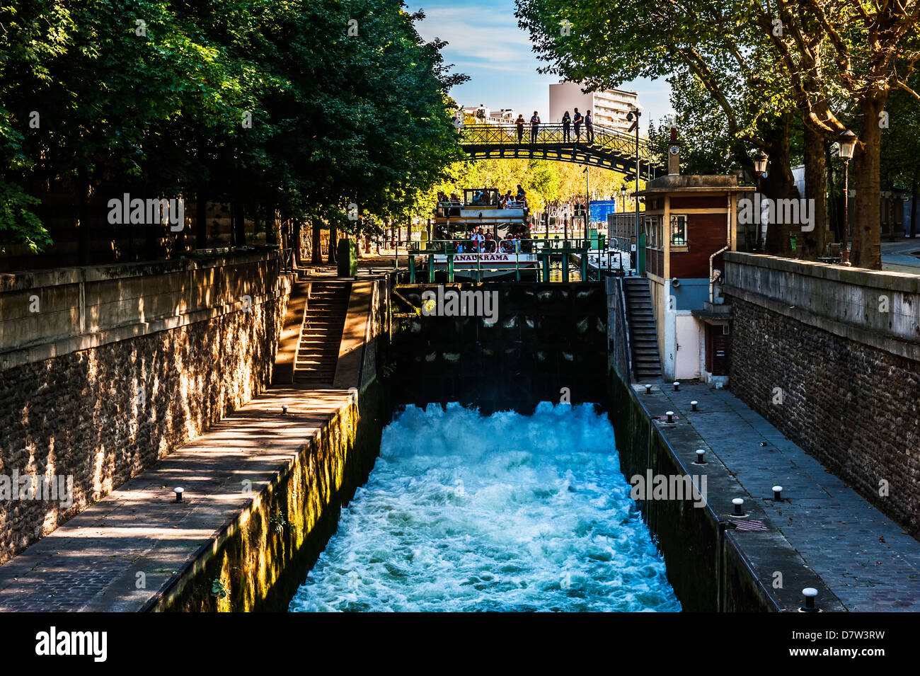 tourist boat in a canal lock canal saint martin paris. Black Bedroom Furniture Sets. Home Design Ideas