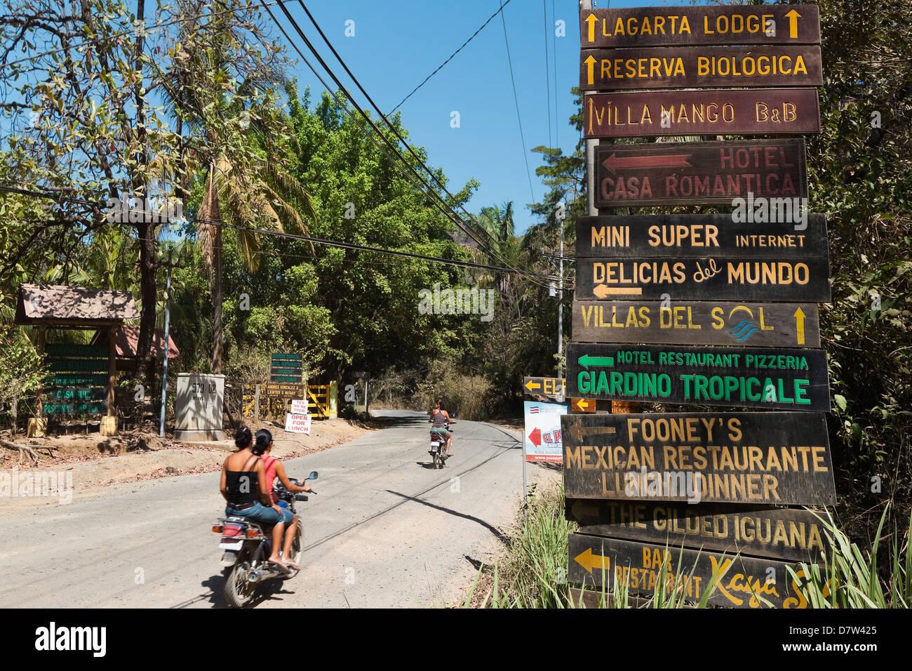 Signs for tourists near popular Playa Guiones beach, Nosara, Nicoya Peninsula, Guanacaste Province, Costa Rica - Stock Image