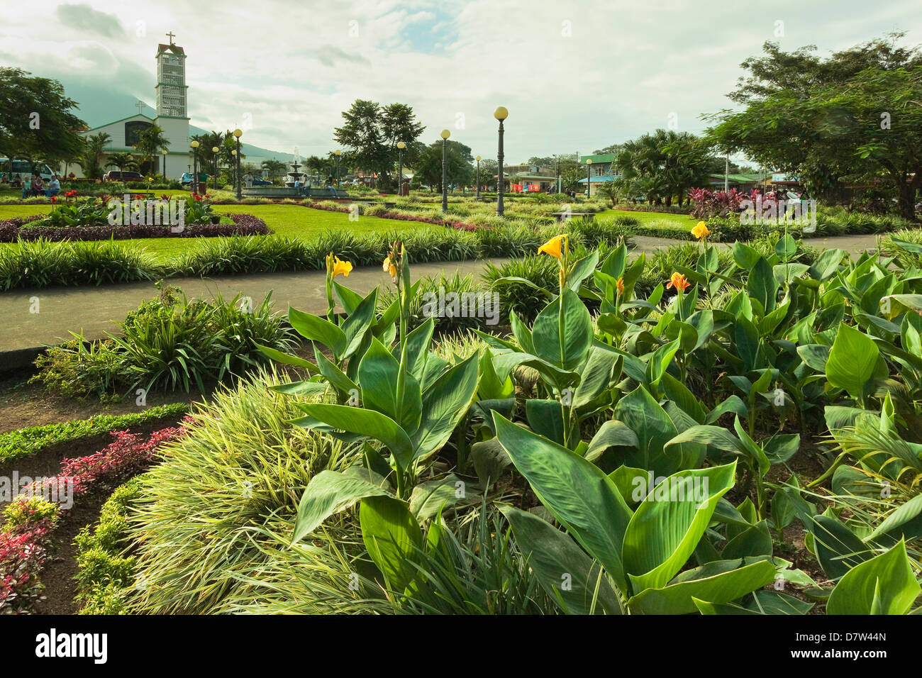Church and park in this tourist hub town near the hot springs and Arenal Volcano, La Fortuna, Alajuela Province, - Stock Image