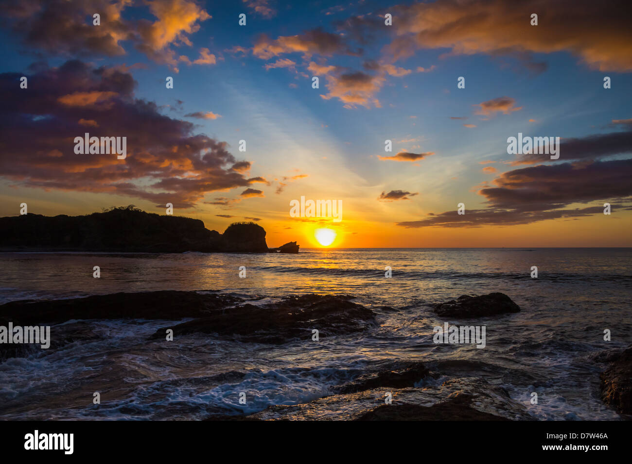 Sunset by the southern headland of beautiful Playa Pelada beach, Nosara, Nicoya Peninsula, Guanacaste Province, - Stock Image