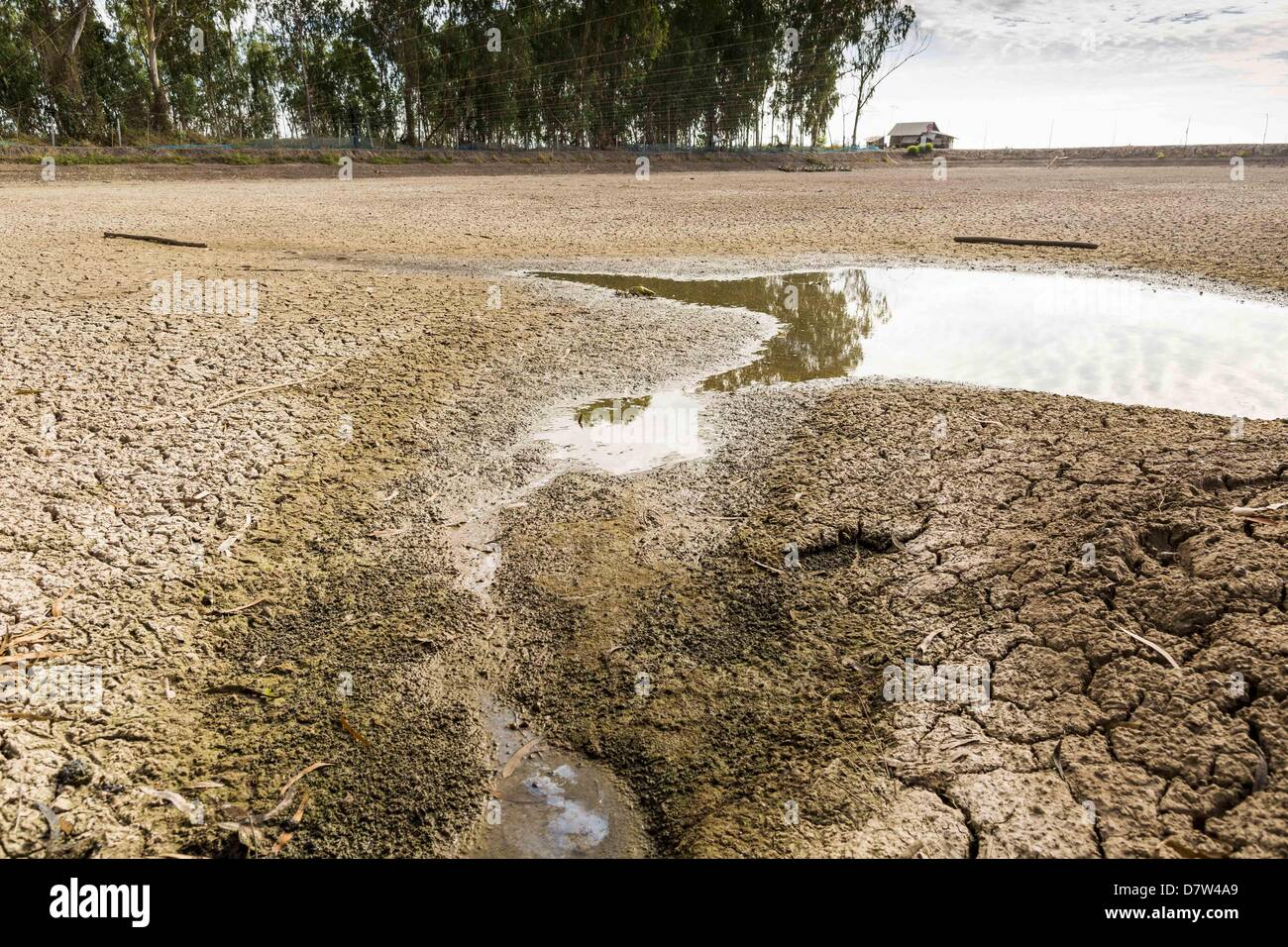 Bangtathen, Saphun Buri, Thailand. May 14, 2013. An empty shrimp pond on a shrimp farm in Saphunburi province of Stock Photo