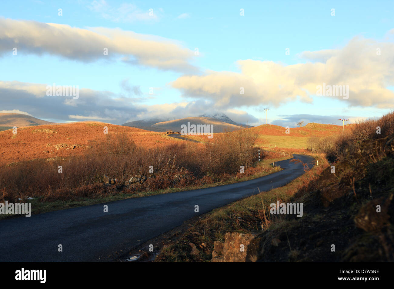 Single track road with passing places on the Isle of Mull with Ben More in the centre of the picture - Stock Image