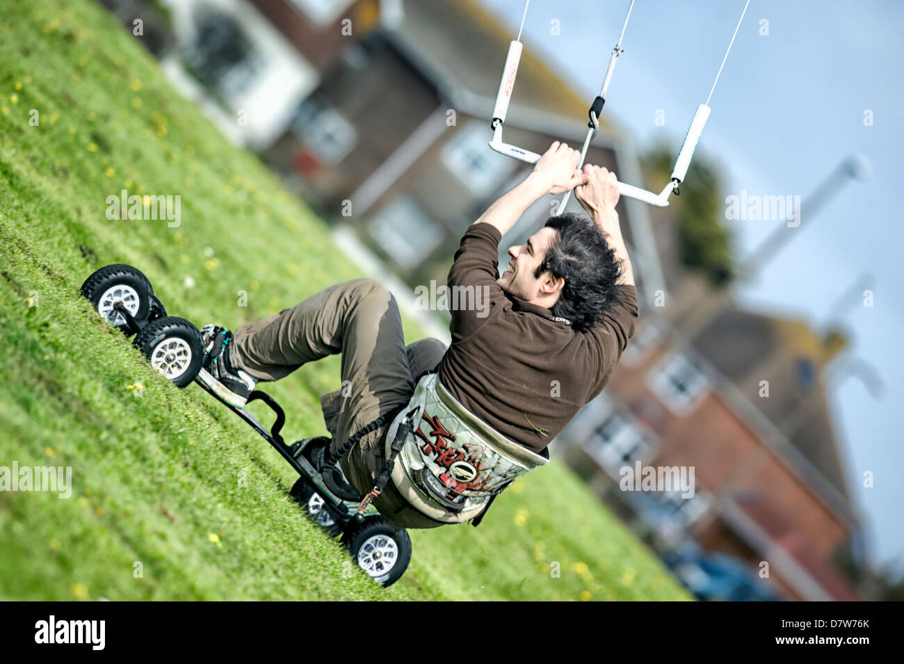 A land boarder at speed on freshly cut grass at Goring Gap, Worthing. Features Slight Blur bue to speed of action - Stock Image