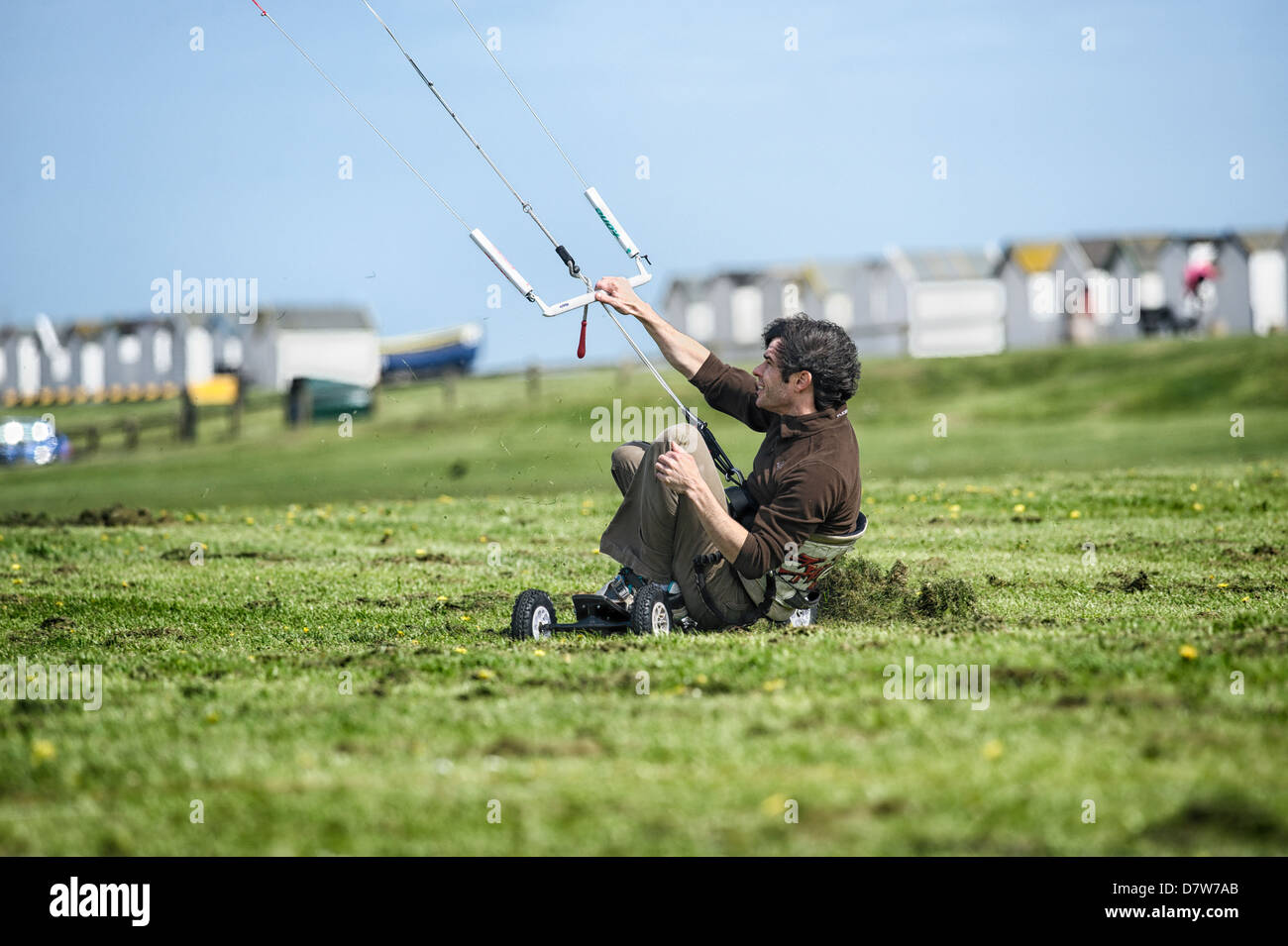 A land boarder at speed on freshly cut grass at Goring Gap, Worthing. Features Slight Blur due to speed of action - Stock Image