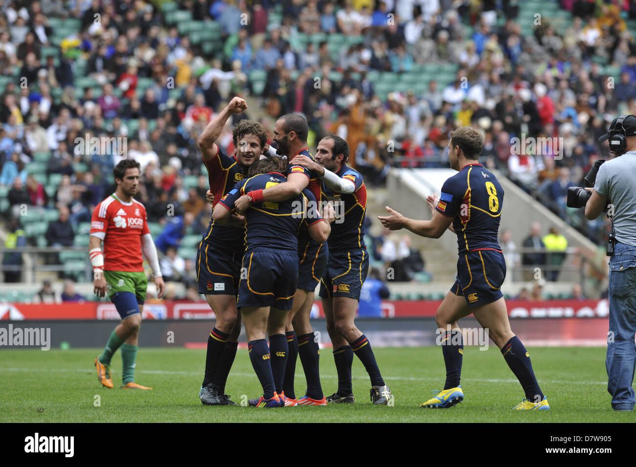 Members of the Spanish Rugby Sevens team celebrating their win over Portugal in the series qualifying final at Twickenham. - Stock Image