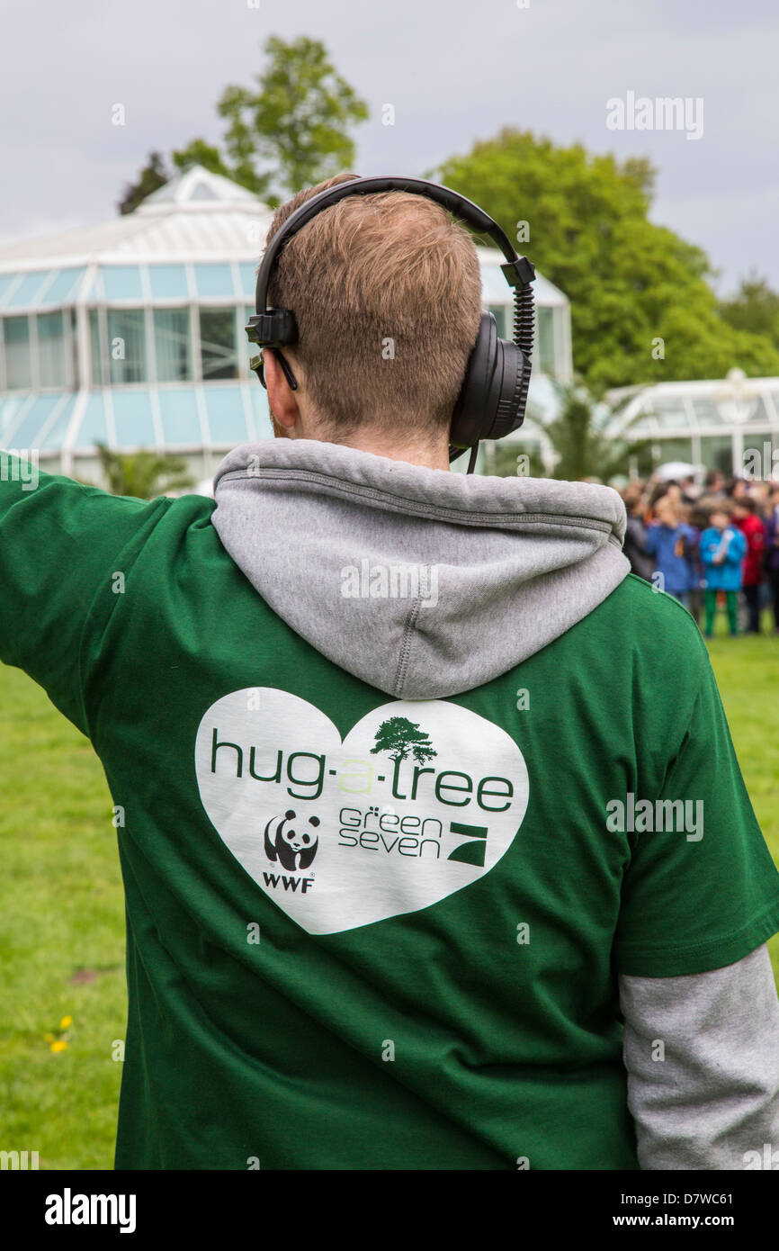 Hug a tree, world record. 848 people hugging a tree at same time. World record for Guinness book of records. initiated - Stock Image