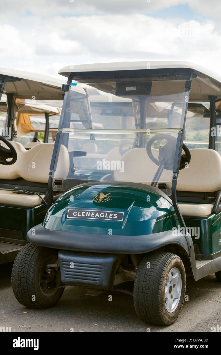 Electric Golfing buggies at Gleneagles golf course receiving battery charging. - Stock Image