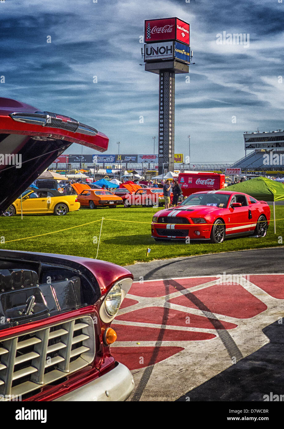The semi annual car show at Lowes Speedway. The scoring tower and beautiful  Carolina sky can be seen in the background. - Stock Image