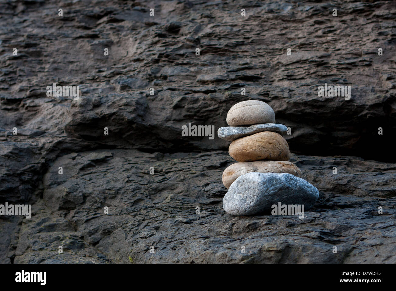 Stacked Pebbles forming a small cairn Stock Photo