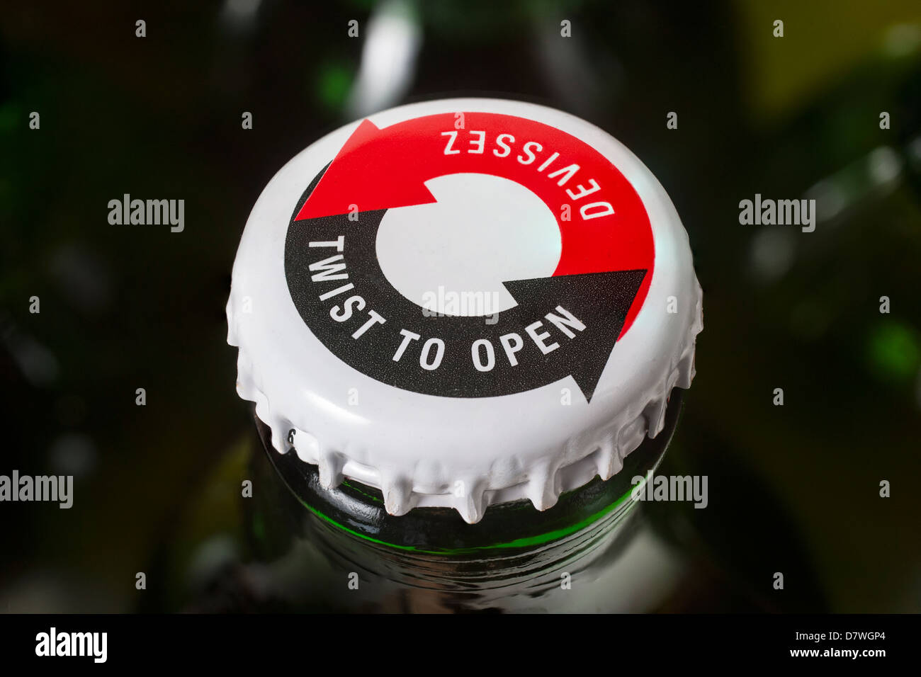 A twist off cap on a beer bottle - Stock Image