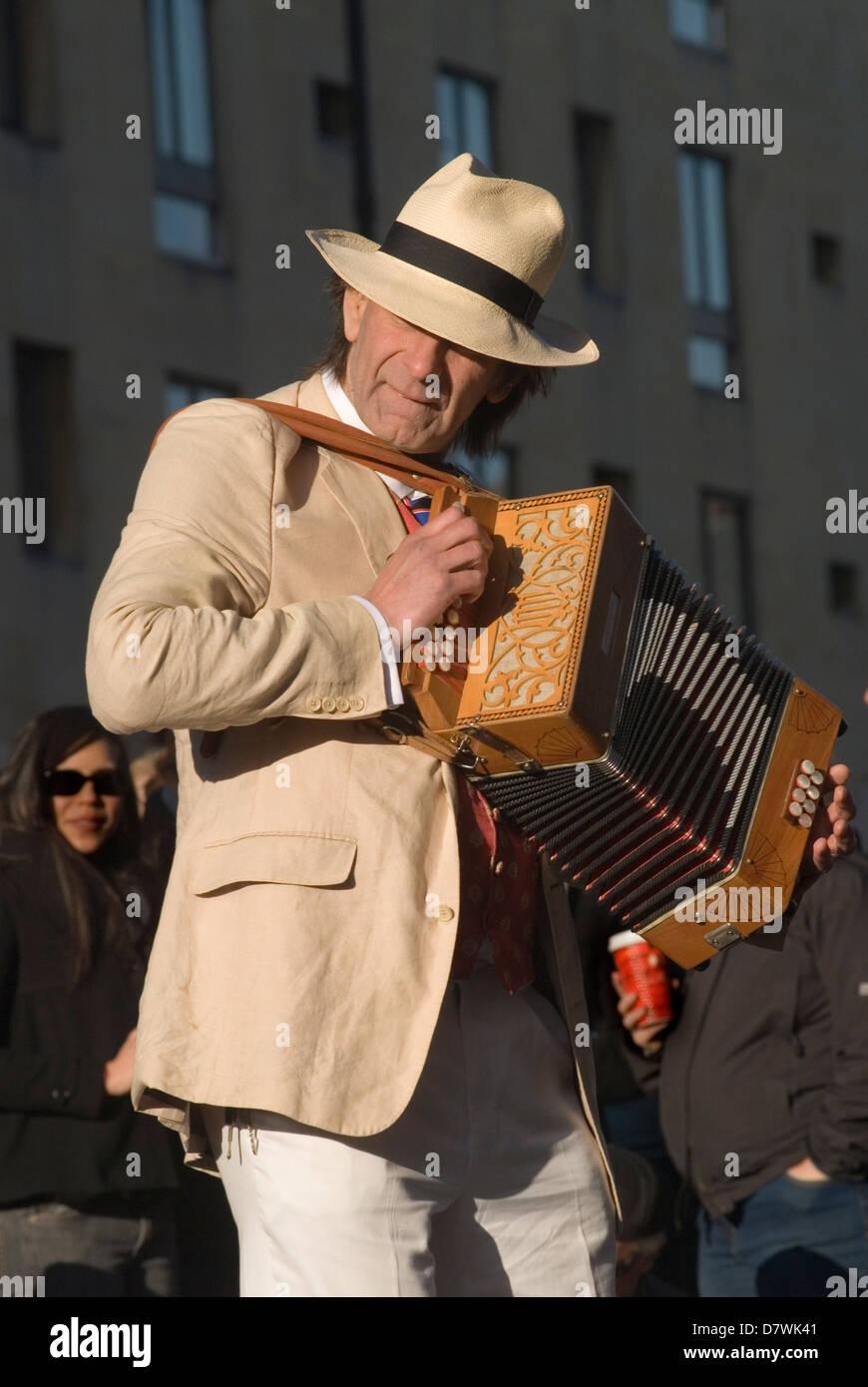 Man playing folk music accordian player Oxford, Oxfordshire May Morning. - Stock Image